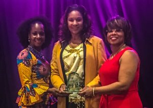 "Dr. Ramona Tumblin-Rucker, PEng, MBA, MPM, CHC, D. Mgt., Director of Construction Management at M Property Services (pictured center), receives the ""Private Sector Executive of the Year"" award from MOKAN Executive Director Yaphett El-Amin (left) and MOKAN Dinner Chair Honorable Jamilah Nasheed (right)."